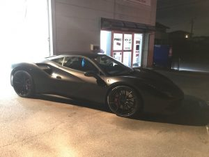フェラーリ488GTBマットブラックフルラッピング施工完成ガレージ外